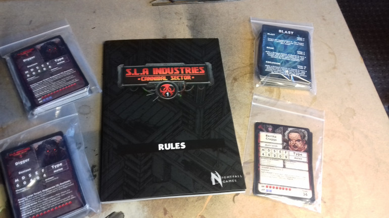 The rulebook. ( We still have the main book to be delivered May/June which as well as the rules contained in this A5 booklet will have loads of background progressing the storyline and leading upto 2nd edition of RPG) and some cards with stats and Ebb abilities (magic/force)