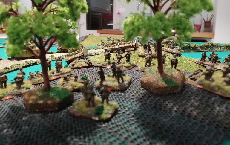 The view from the perspective of the Sherwood Forresters in the trees as the Panzers move up