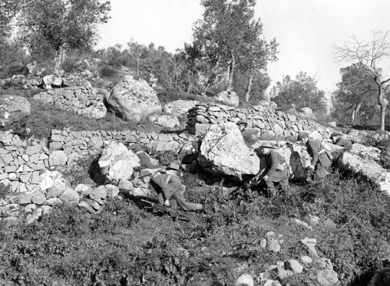 Allied troops advancing up the hill