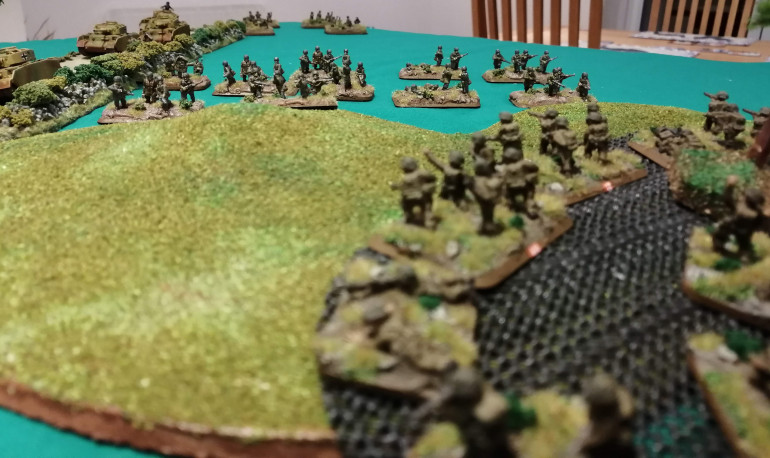 The Sherwood Forresters peer out from their foxholes at the advancing Fallschirmjager