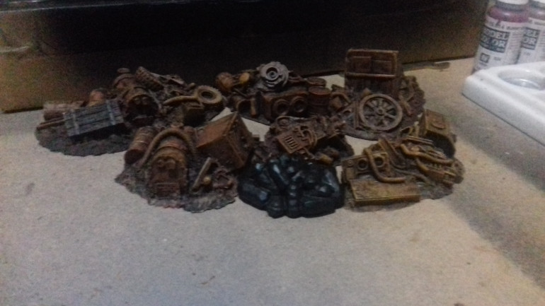 Some resin scenery ex pardulon now available from Crooked Dice. Ihttp://www.crooked-dice.co.uk/wp/product/junk-piles/ have under coated them black and drybrushed them in rust shades