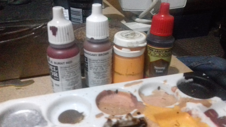 The sequence of paints I used for my rust drybrush, this was followed by a wash of Strong Tone