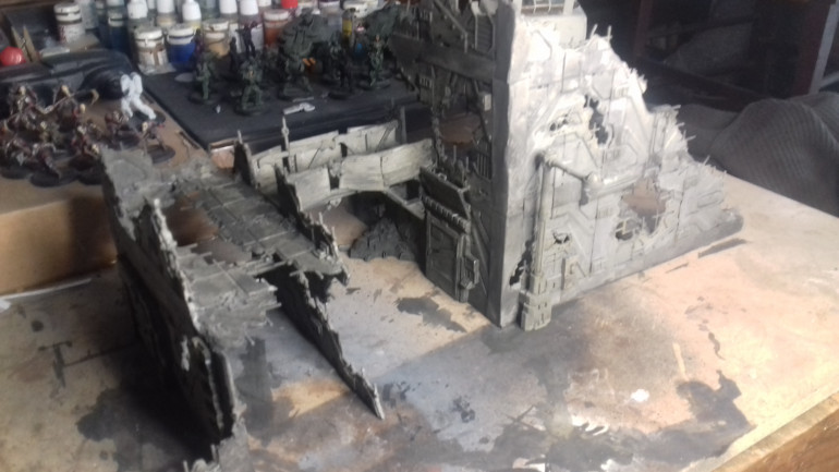 I have now undercoated the building white ( I have run out of Black) and given it a wash mixed from black and pale khaki.