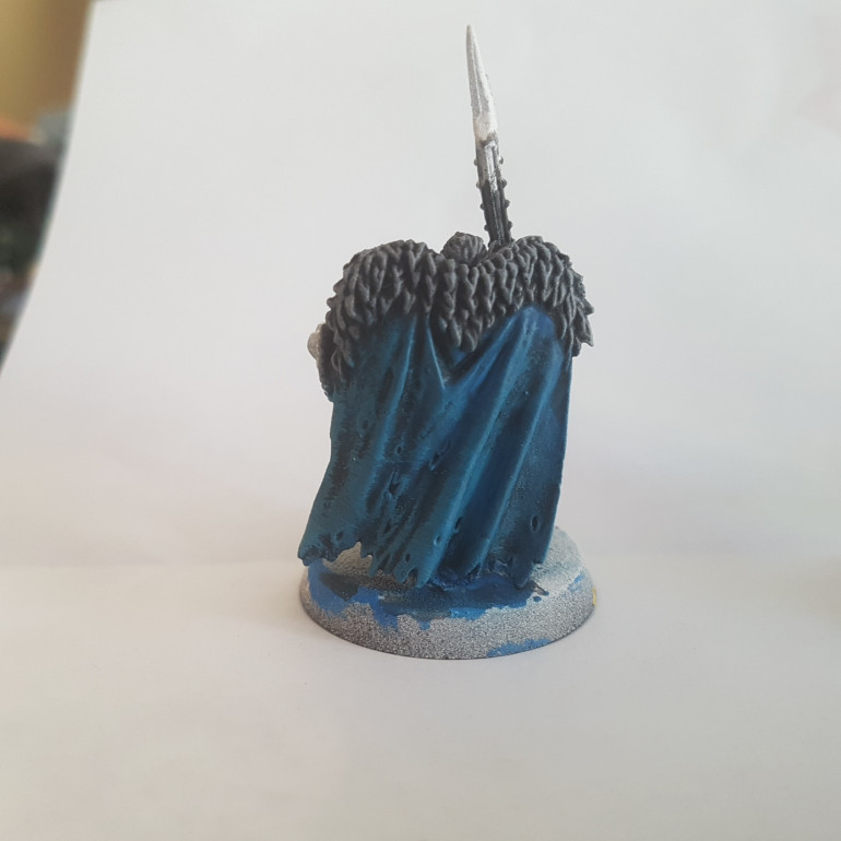 The Fur was Painted with a 50/50 Mix of Army Painter Dungeon Grey and Army Painter Matt White. The Cloak was Painted with Temple Guard Blue