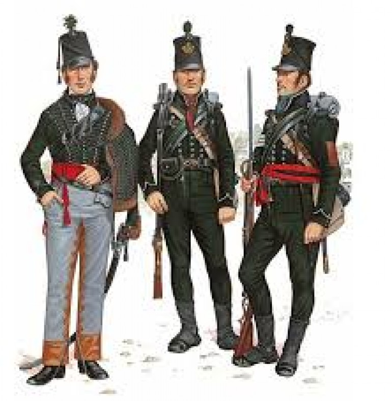 On the left is a Rifle Officer. Note the Leather Reinforces Breeches, Pelisse (Tight Fitting Jacket Worn Slung on the Shoulder like a Hussar), Red Sash that Denotes an Officer, Curved Sabre used by Flank Companies and Light Infantry and the Black Shoulder Strap that has a Whistle in it for Signalling.          Centre: Rifleman. The Black Facings (Cuffs and Collar) Mean that this Rifleman is a Member of the 95th Rifles. The 60th Royal Americans would have Red Facings.            Right: Sergeant. Notice the Same Red Sash as the Officer but with a Black Section, the Colour of the Regiment's Facings. Also Note that the NCO wears a Rank only on the Right Arm. This was also True of the Famous