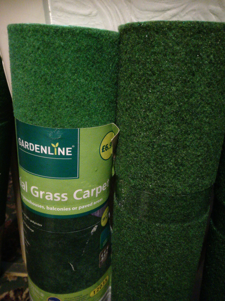 £6.99 from aldi, Artificial grass carpet. Comes in 1m x 2m and available in green and dark green.