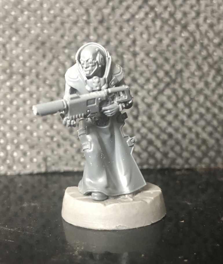 Again, lasgun made by adding a stock to a Delaque laspistol.