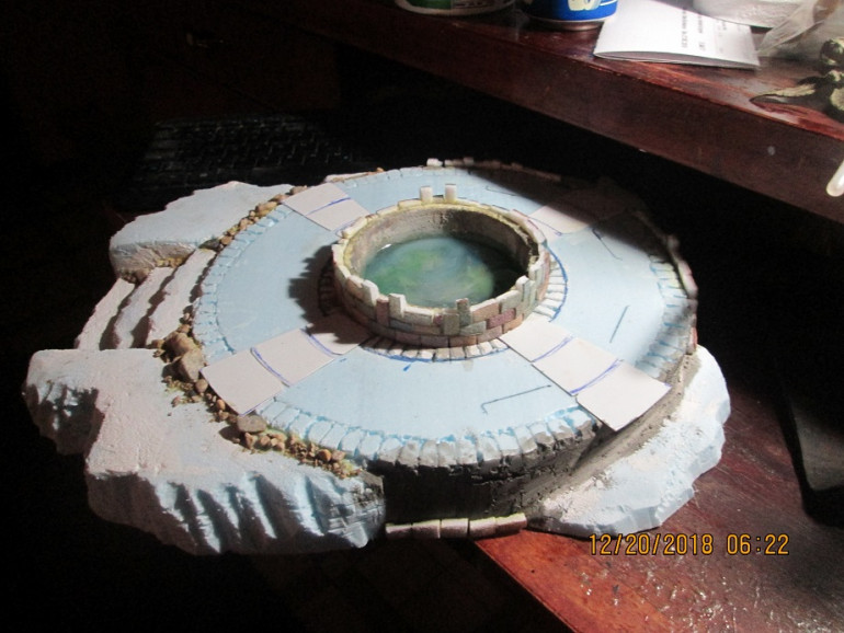 Hill/fountain board showing initial sculpt, first fountain pour, and the start of the brickwork.