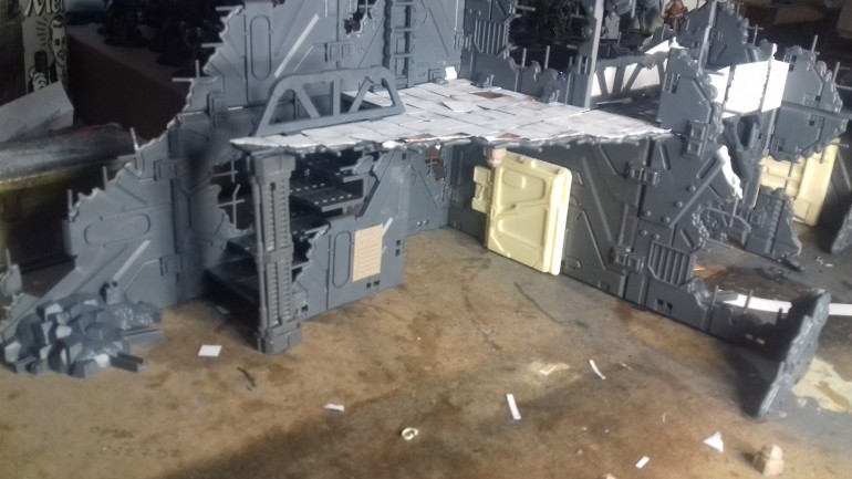 The interior of the main building. All the doors are from Antenociti's Workshop, I bought a couple of packs and then moulded and cast up some extra ones.