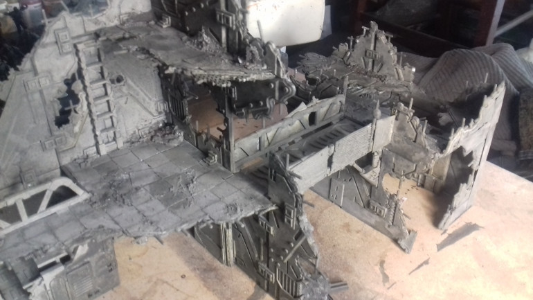 I am really pleased now that the whole thing has been undercoated as the building to my eyes looks like a building and not like a collection of plastic squares. I need to touch up a couple of areas where white is still showing through, and then I can start drybrushing and adding detail.