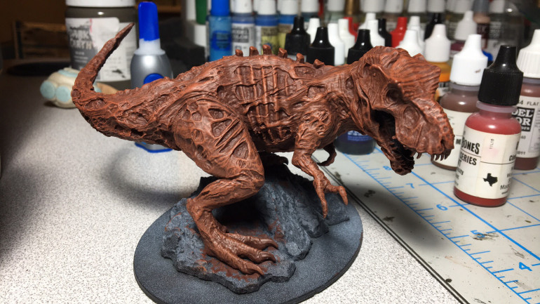 I base coated in vallejo's Hull Red then added a bit of Flat Brown via drybrush.