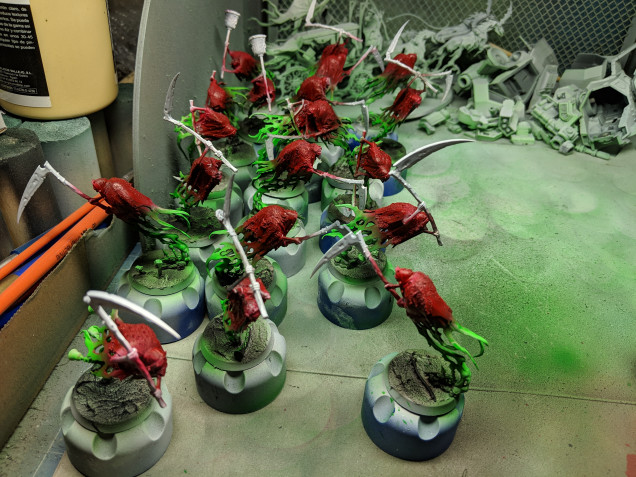 Gloss varnish on the grayish cloaks and a crimson ink worked wonders