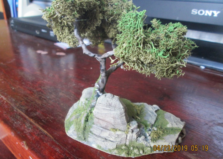 The final step was to apply the foliage with a glue gun,  and drybrush a leaf green on it where it had faded to brown in the bag (actually, that's two steps). It's not quite the colour I wanted, but at the finishing stage, all the deciduous trees will get a slightly yellower highlight.