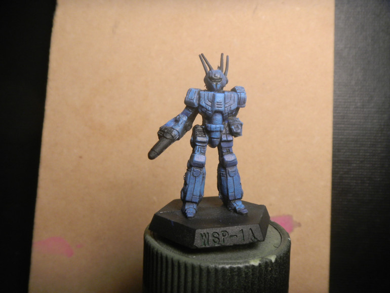 Drybrushed base of  ultramarine blue, highlight electric blue and edge with voidshield blue
