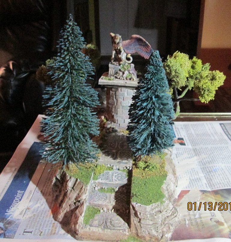 Front view showing angled trees and available space for models both on the piece and beneath the boughs on the tabletop.