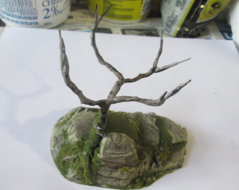 I painted the roots then added foliage to the base, again a few different Woodland Scenics products. If you're skinnt you need look no further than your spice cupboard for small amounts of ground cover. Thyme, parsley, and oregano are all great choices for adding variety and texture. I once had a player whose favourite colour was 'paprika,' so upon request, the base of her miniature was covered in the stuff... artists *Shakes head.*