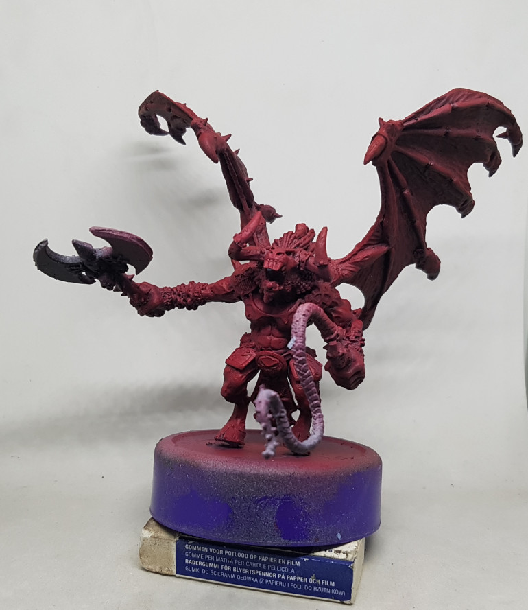 The Daemon was previously given a zenithal preshade and left overnight to dry.  I then dropped my airbrush prssure down to around 15 and thinned my paints down much futher and put a coat of VGS 72.111 Gory Red over the model.  This came out too pink for my tasts so I swapped it out for VGC 72.012 Scarlett Red.  The underside got minimal attention but the side and top got progressively more, still allowing the preshade to influence the colours