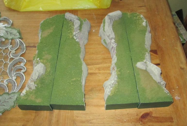 I added flock and foliage to the pieces, and was quite happy with the result, particularly along the edges where the flock further covers the seam between the foam and protective plastic.