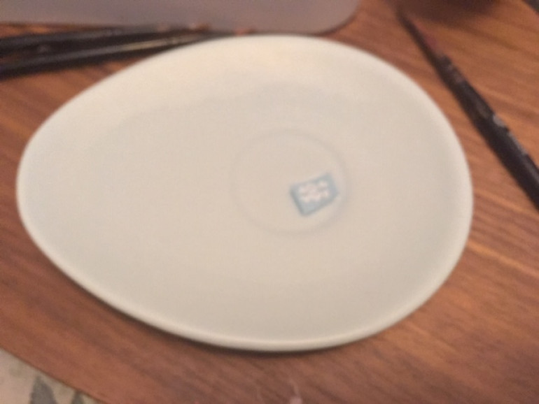 Put the transfer in a small saucer of water. I use a Nigella Lawson egg shaped saucer, but cheaper alternatives are available ;)