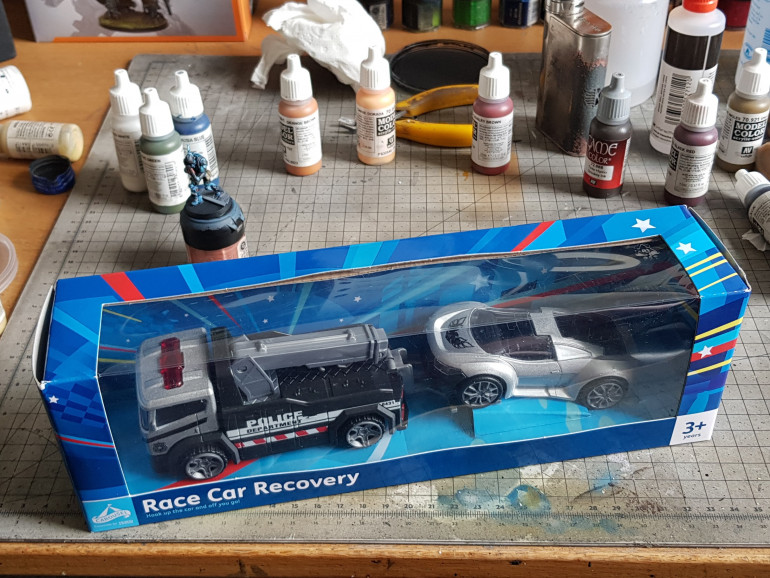 The toy car set in tesco was £5 I dont like the truck it seems like a smaller scale but may (will) have other uses for it later.