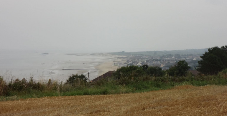 A few years ago I travelled to ALL the Normandy beaches, landing zones, and battlefields, from Pointe du Hoc to Falaise.  These are some of my photographs of Gold Beach.  This is looking east from atop the bluffs east of Arromanches, so I believe this is looking down onto either Jig or King Sector assault beaches.  The trip was a few years ago.  Either way, the beaches on our Panzer Leader board look a lot like this.
