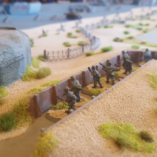 British Troops Move Into Position For A Beach Assault