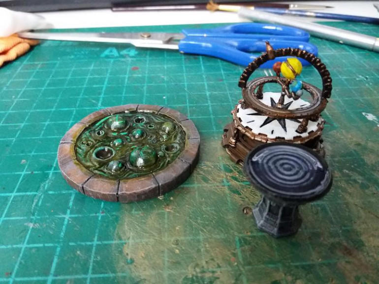 Pensieve and Orrery from Mantic and a bubbling pool of something from Oathsworn minis