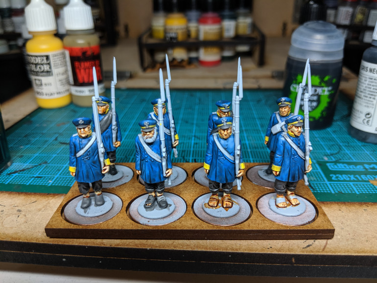 Dark colours and flesh done. Just need detailing (and gun stocks, no idea how I missed them!)