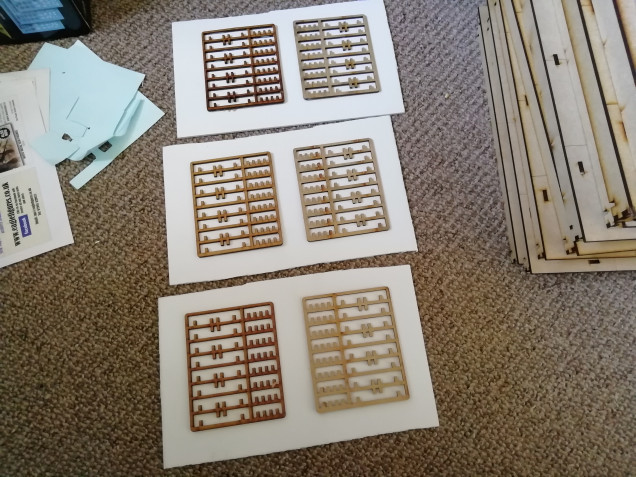 I saved some old srues from an MDF kit and used them as patterns for the walls.
