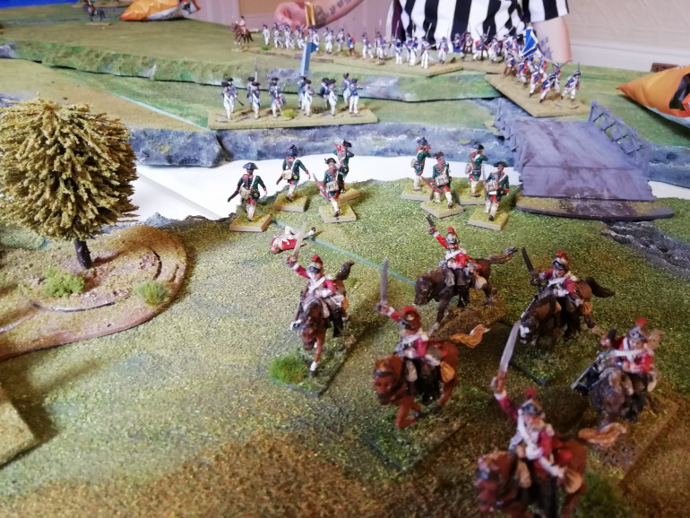 Dragoons fallback over the bridge and rally for one more charge