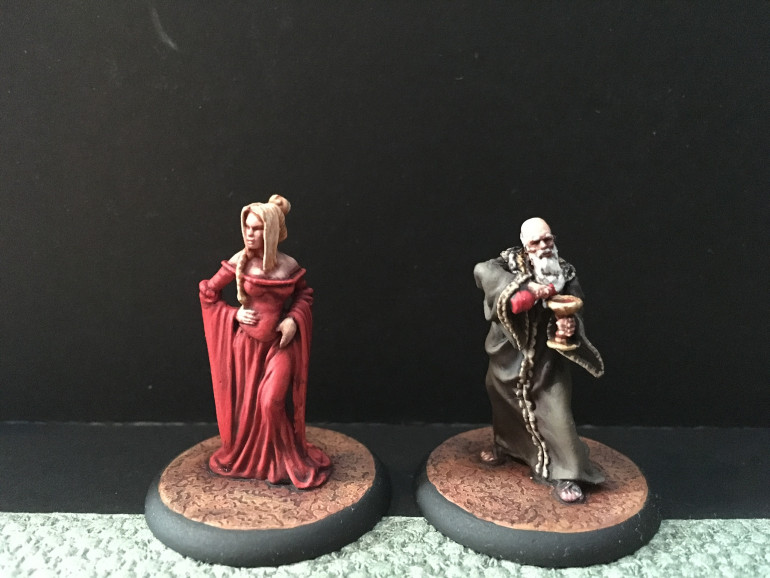 Queen Cersei and Grand Maester Pycelle.
