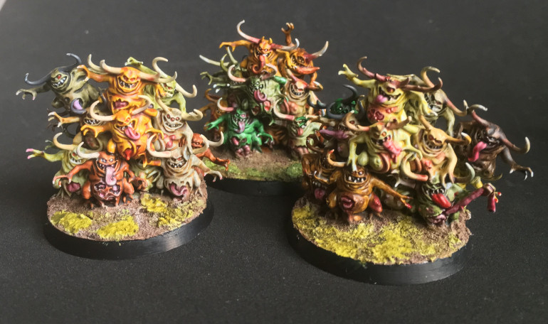 Ended up adding a few extra slimy bits on the Nurgling bases. I need to learn to stop.