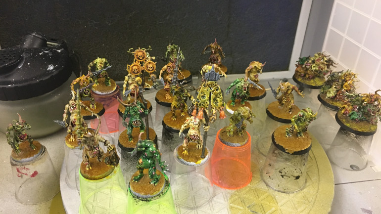 All 20 washed with Casanova Yellow.  Nurgling's bases got a wash with it as well.