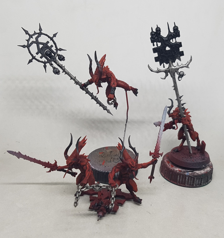 It's sunday now and I started work before 8AM and it's 10.30AM now.  I have the iron done for the Bloodletters, and I've started work basing the Bronze.  I'm focusing on the red guys only for now.