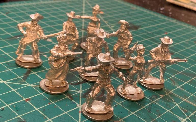Raw miniatures, cleaned up a little and mounted on nickels.