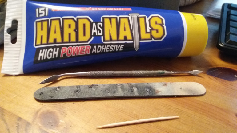 what you need: a lollipop stick to use as a base, sticks to poke and prod with and grab adhesive, this paticular stuff is from poundland