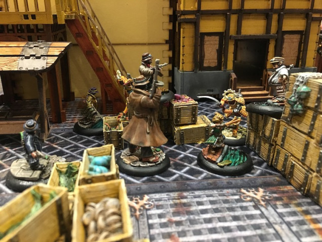 Neither side seemed able to gain an advantage until the two halfling workers were cut down.  Luigi and the ogre were able to cut lose with bonus due to their Familia rule but neither side had lost a character yet.