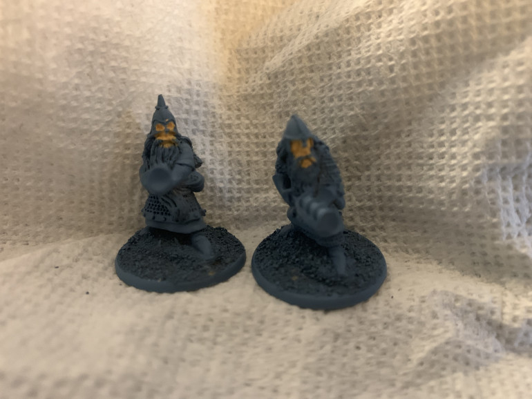 The handgunners only have two poses and they're wearing gloves so pretty much we're just painting the faces. Because of the dark primer, it'll probably take two light coats.