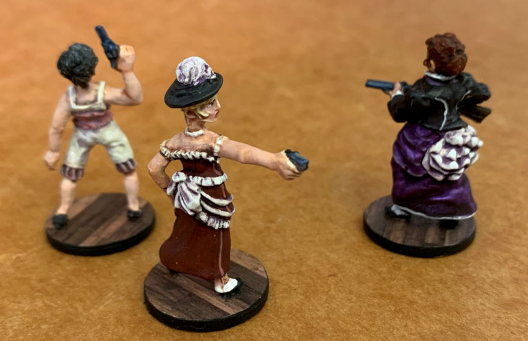 So I sawed the women off their metal bases and re-based them on new American nickels, covered in hardwood floor pattern I printed on cardstock.  This is because these figures will be on porches, balconies, etc ... on or in saloons rather than standing out in the open prairie.