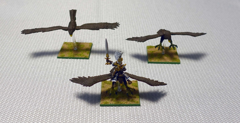 My eagles stood on round bases. The bases were removed and replace by 50 mm square bases.