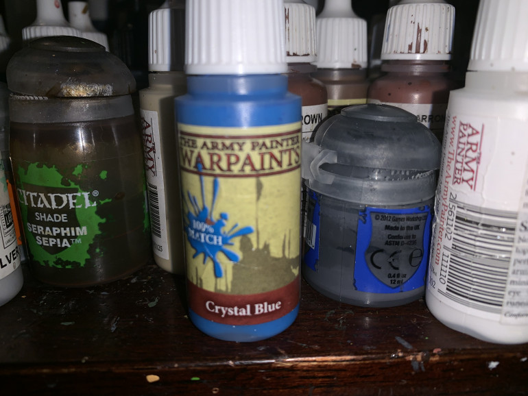 Army Painter Crystal Blue for the wizard's orb. I'll use this color later on some of the magical creatures.