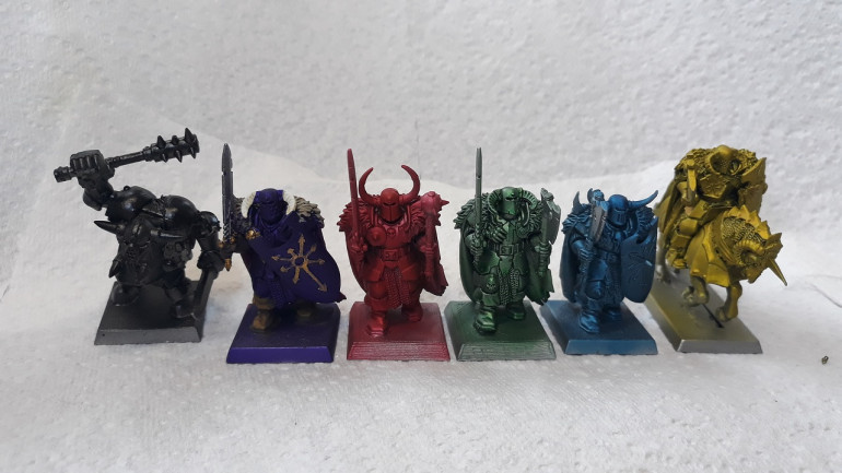 Examples left to right - Vallejo Game Ink Black; Vallejo Game Ink Purple (apologies this guy is already part-way through his paint job..), Vallejo Game Ink Red, Army Painter Green Tone, Army painter Blue Tone and Vallejo Game Ink Yellow