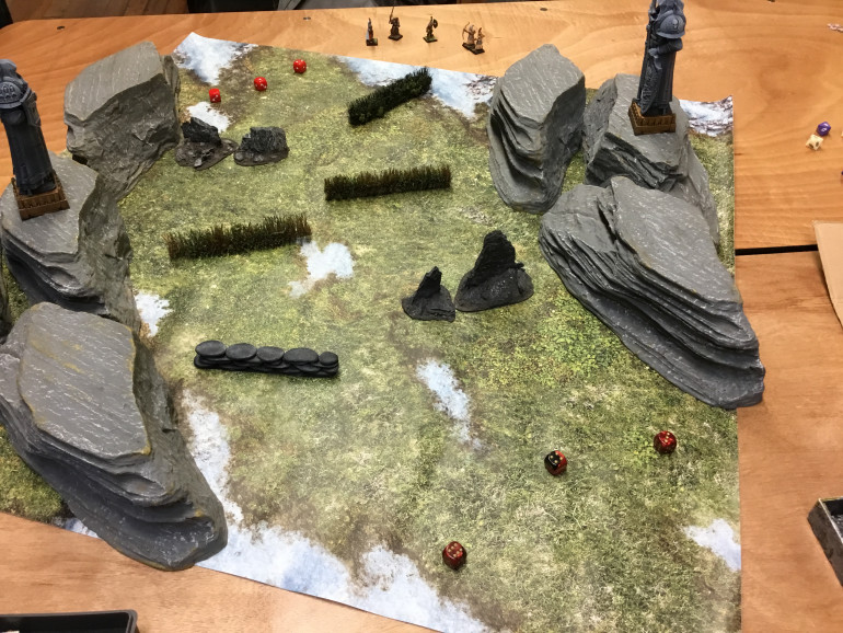 Set up a canyon using some of Gamescape San Francisco's terrain. We played during the Wed. nights skirmish sessions .