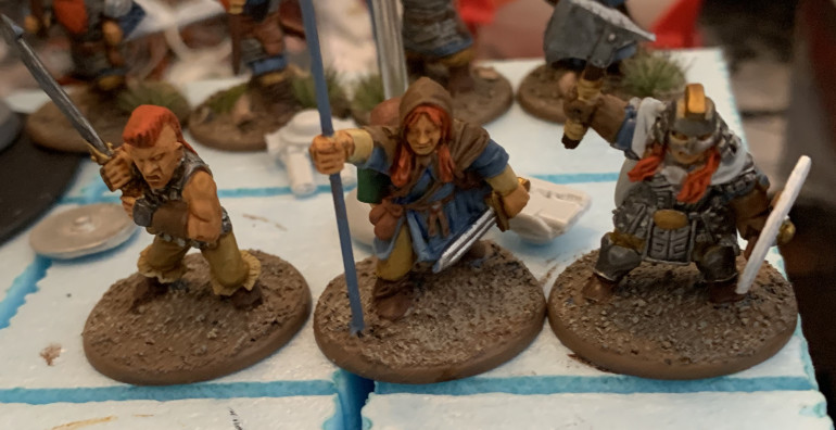 These figures are from Bad Squiddo Games. The figure holding the banner pole is a conversion of the torch bearer figure.