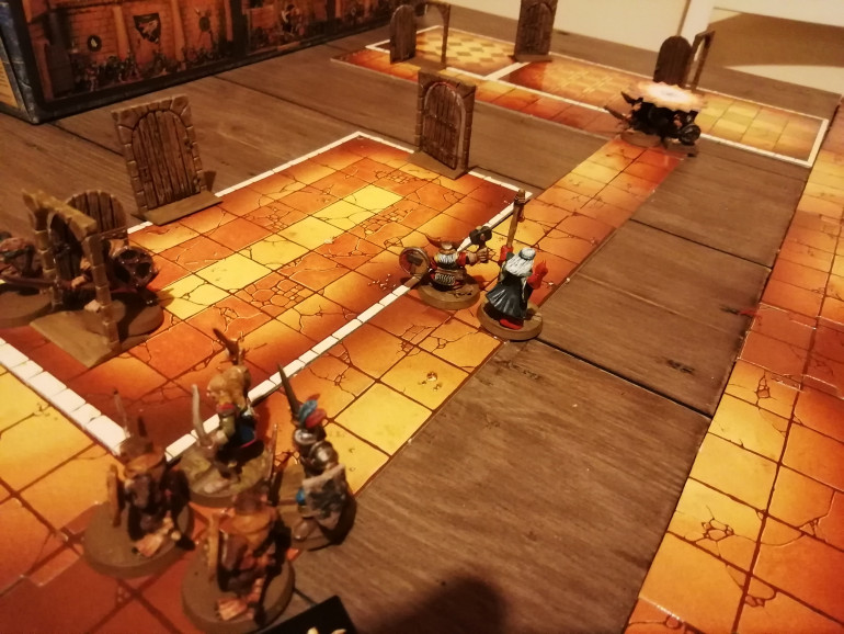 Searching for stairs down to the next level our heroes are ambushed in a corridor from both sides. The wizard throws a ball of flame clearing the rear whle the elf and warrior chop up the ones in front.