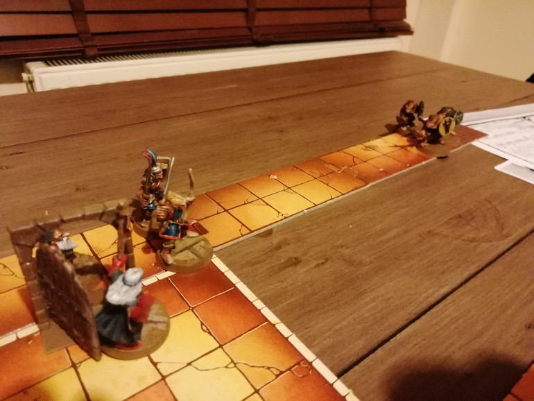 After exploring the first room they find another way out of the dungeon under guard. These Skaven are dispatched.
