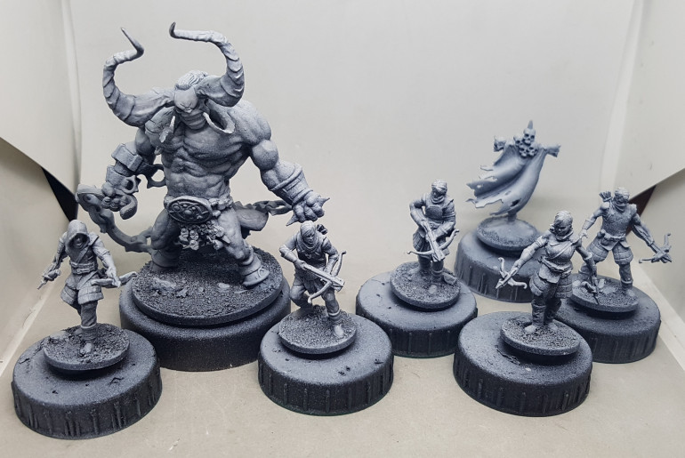Here they are, all primed and ready for paint.  I've 2 other models to paint first, but I will work on this guy done before Christmas.  i think they look better for being primed.  Perhaps the plastic disagrees with my eyes?  Perhaps the zenith just enhances the sculpts.  Either way, they are more inspiring now, although perhaps some of the detail is a little shallow and may not hold up to the incoming ham fisted heavy painting?