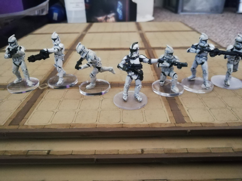 Squad done in contrast paints. Quick but a bit messy in my opinion. I found it hard to cover mistakes especially when using a very dark colour next to white.