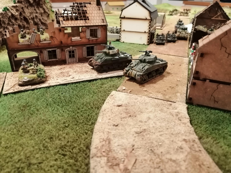 Tank Platoon 2 round the corner to deal with the 7.5cm Infantry Guns
