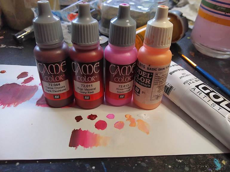 Skin paints. Note the tube of white on the right side.